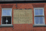 Ghost sign for Whitbread's Ale & Stout and Mackeson's Stout on High Street in Somerby.