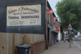 Ghost sign for Ginns & Gutteridge, Funeral Undertakers.