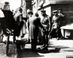 Photograph of King George V and Queen Mary on visit to Corah factory, 1919
